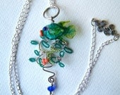 An Artisan Handmade Glass Fish in Sea Plants in Teal, Coral and Grass green on Sterling silver chain