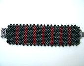 Luxuriously Nubby Cerise and Grey Green Striped bracelet with black onyx trim
