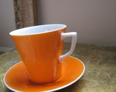 orange cup and saucer -demitasse
