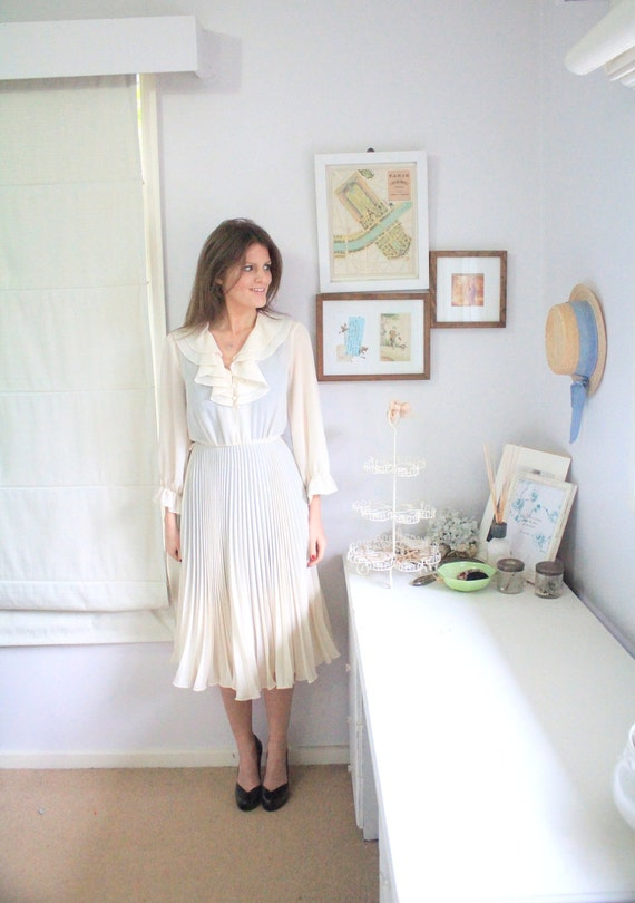 Eliora dress. Floaty 1960s cream cocktail dress, sheer sleeves, collar, bow waist. S