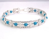 Blue Skies - turquoise and sterling silver wire wrapped bracelet
