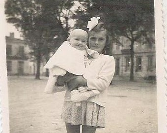 1930s French photographie young girl carying a baby