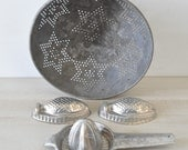 fun group of vintage silver farmhouse kitchen items---fish tin molds, juicer, star pattern strainer