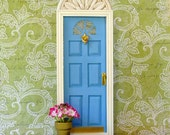 Fairy Door in periwinkle blue, with architectural detail and potted flowers