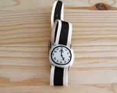 Fake watch bracelet. One-of-a-kind handmade Porcelain toy clock with B/W striped watchband.