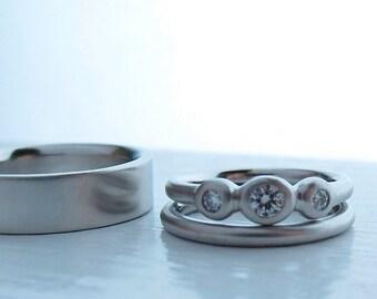 Platinum and Diamond 3 diamond ring, bezel set diamonds, matching wedding bands complete wedding set