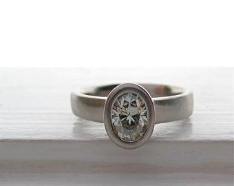 Ellipse Ring 950 palladium and Moissanite Engagement Solitaire