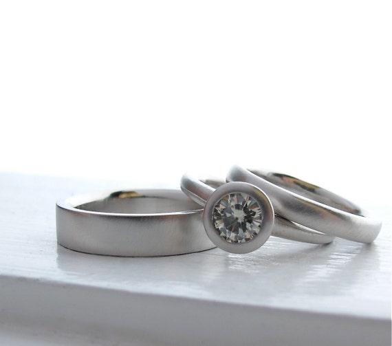 palladium and moissanite engagement ring and by