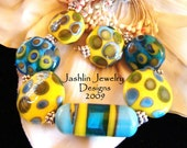 Spring Colors of Turquoise and Bright Yellow combine for a Set of 7 Lampwork Beads  SRA