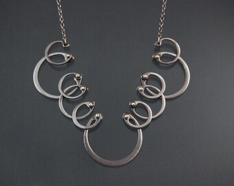 Kinetic Snap Ring Necklace