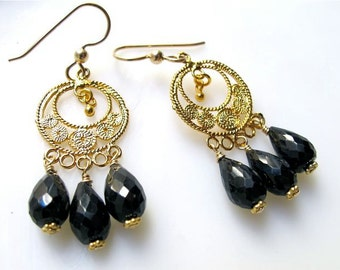 Gold chandelier filigree earrings with black onyx drops. MYSTERY