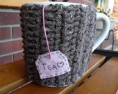 handmade crocheted tea mug cozy or cup cozy in barley brown with light pink eco felt tea bag