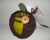handmade crocheted apple cozy or apple jacket or apple coozie in beautiful chocolate brown with green leaf