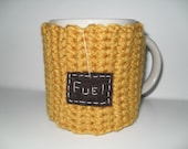 crocheted mug cozy or cup cozy in mustard gold yellow with brown fuel patch
