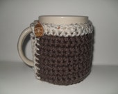 crocheted coffee mug cozy or tea cup cozy in dark taupe with oatmeal ivory creak fleck trim
