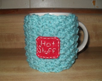 Handmade crocheted coffee mug cozy or tea mug cozy in robin egg blue with red Hot Stuff patch