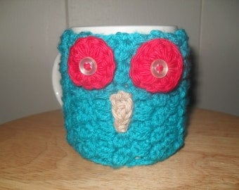 Crocheted owl face mug cozy cup cozy in peacock blue and red