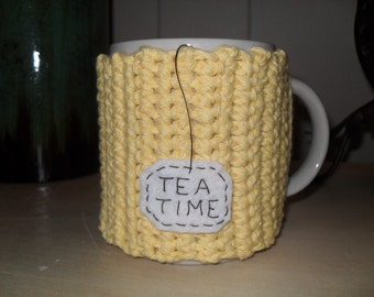 handmade crocheted yellow tea mug cozy with eco felt hanging tea bag eco friendly