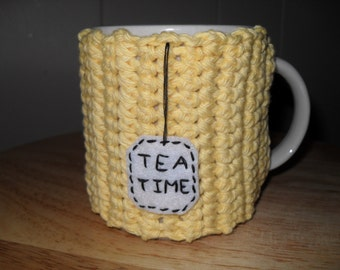 handmade crocheted tea mug cozy or cup cozy in yellow with tea time tag