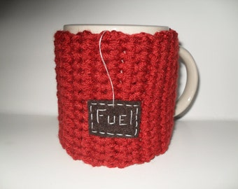 crocheted mug cozy or cup cozy in burnt sienna with brown fuel patch
