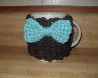 Crocheted mug cozy cup cozy in brown with aqua blue turquoise bow