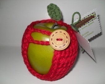 handmade crocheted apple cozy, apple coozy, or apple sweater in beautiful true red with green leaf  eco friendly