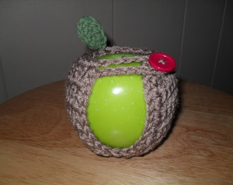 handmade crocheted apple cozy or fruit cozy in taupe