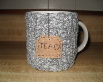 handmade crocheted tea mug cozy in grey gray and white marble with hanging tea love tag eco friendly