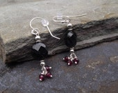 Shadows and Darkness Round - Black Spinel with Garnet dangles - 1.5 inches