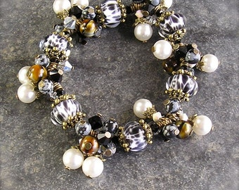 Black Tie Affair,  Lampwork bracelet, stretch bracelet, black and white bracelet, stretch charm bracelet, zebra stripe bracelet