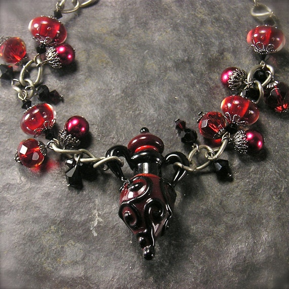 Temptation a Lampwork Perfume Bottle Bracelet in blood red and midnight black