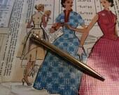 Joan Holloway Gold Pencil Pen Necklace