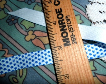 """14 continue yards of White knit trim with tiny blue stars - 1/2"""" wide"""