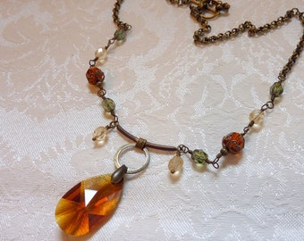 Deep Amber Crystal on a Brass Ring necklace