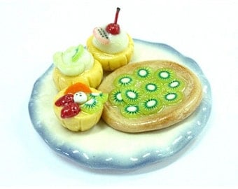 Miniature Foods Polymer Clay Cupcake and Giwi Tart on blue and white ceramic plate