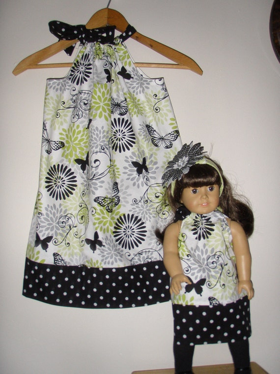 On sale normally 20.99 now 17.84 Butterflies and polka dots pillowcase dress- matching American Girl Doll dress (size large or xlarge )