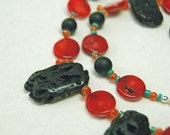 Eruption lava and red coral necklace by JosiesBeadedJewelry