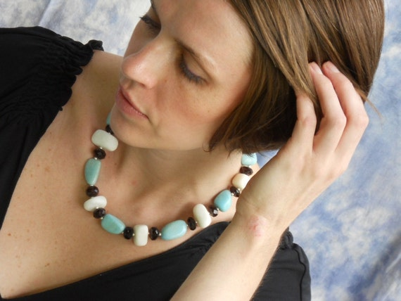 She was an American Girl necklace - red glass, white calcite, robin's egg blue marble