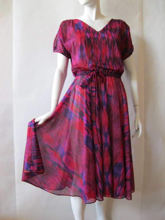 1970's flowy dress, raspberry, purple, and red semi sheer layered fabric, about a medium