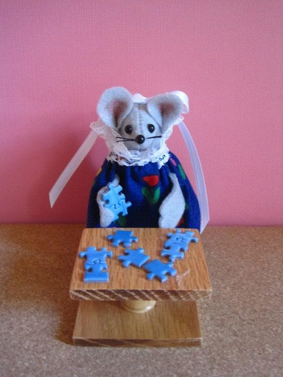 Felt Mouse Doing a Puzzle