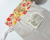 Natural linen drawstring kinchaku pouch - Orange floral lawn