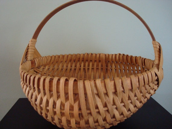 Vintage woven egg basket with wooden handle