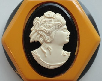 Rare Large Vintage Bakelite Brooch in Butterscotch and Black with Carved Cameo