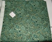 Green and gold paisley fabric