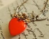 a delicate tattoo (raw brass on orange) - vintage brass flower orange glass heart necklace