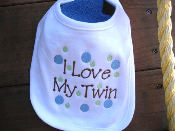 Cute embroidered bibs for twins.