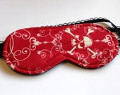 Eye Mask / Sleep Mask in red with glow in the dark skulls and scrolls