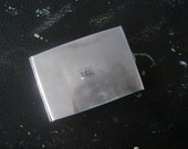 Vintage silver coloured cigarette case with engraved initials E.G.L.