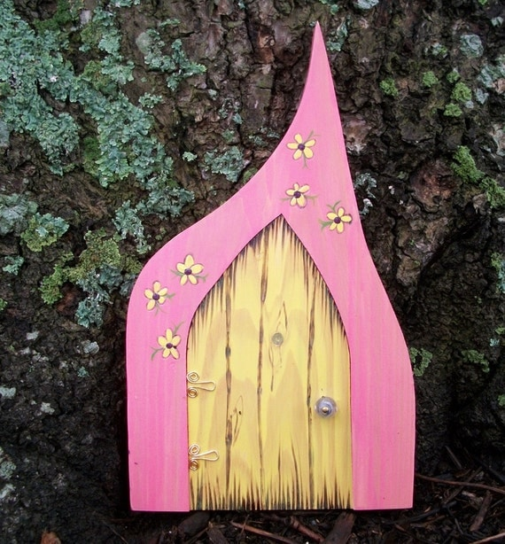 Pink wooden fairy door in a gothic style with pink and yellow for Pink fairy door