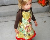 SPICED PUMPKIN......NEW FOR FALL AND WINTER.... A line jumper with Matching Flower and Headband